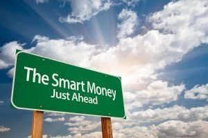 Road sign showing that the smart money lies ahead