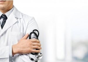 Doctor with a stethoscope waiting to perform a medical exam on a new patient