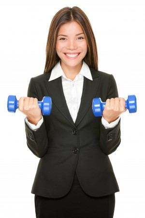 Woman dressed in suit who is lifting barbells....she is flexing her muscles when it comes to asking for a raise