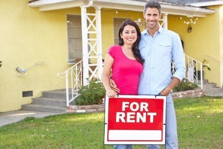 Single family home for rent with a landlord standing in front