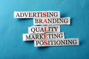 Advertising sign which shows how branding and marketing lead to sales