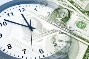 A clock with dollar bills on it