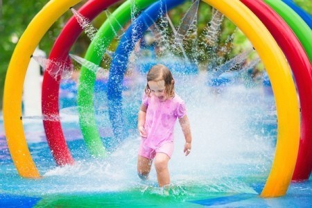 Girl playing in the water at a local water park