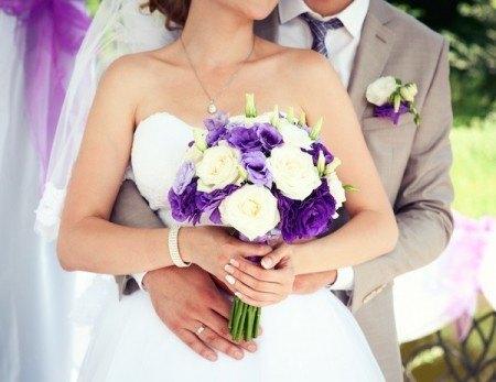 Bride holding a beautiful handmade wedding bouquet