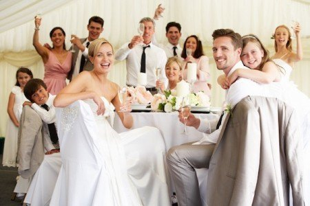 Friends of the bride and groom celebrate after the wedding at the reception